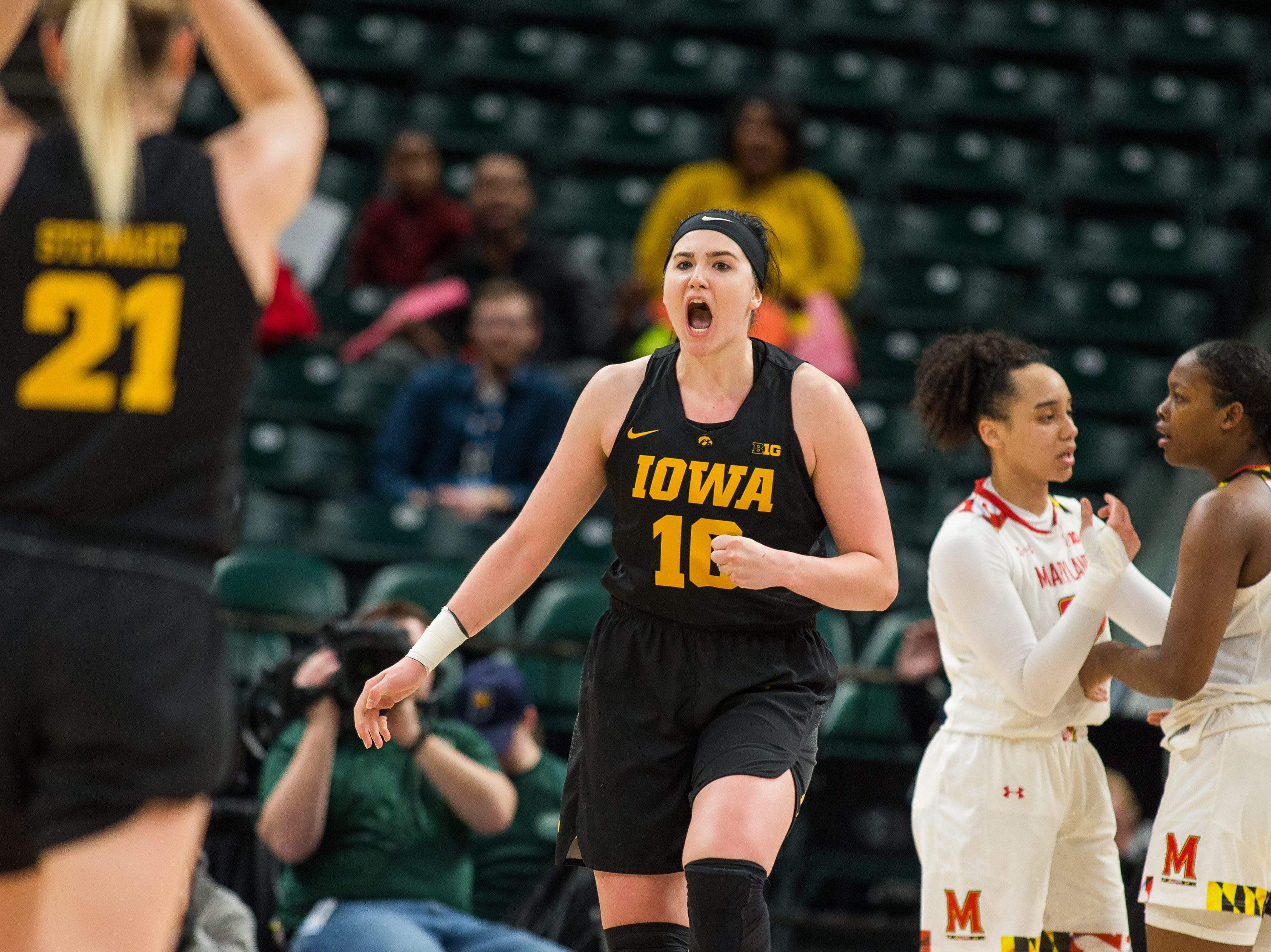 Iowa Hawkeyes forward Megan Gustafson (10) reacts to an and one play in the first half against the Maryland Terrapins in the women's Big Ten Conference Tournament at Bankers Life Fieldhouse.