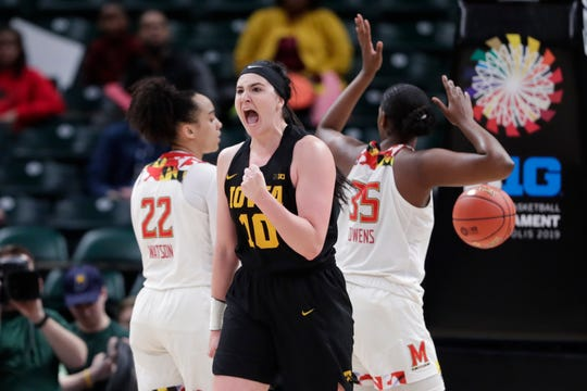 Iowa forward Megan Gustafson (10) celebrates after being fouled by Maryland players in the first half of an NCAA college basketball championship game at the Big Ten Conference women's tournament in Indianapolis, Sunday.