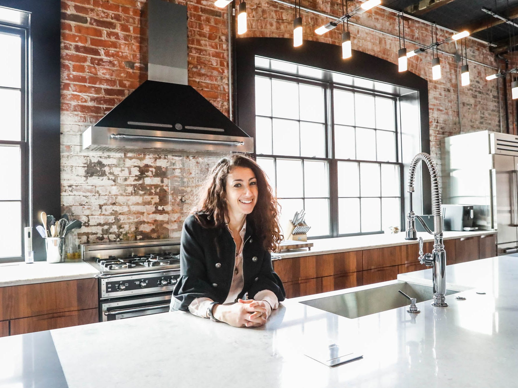 "Rachel Prince, an Indianapolis-based Airbnb ""superhost"" and manager for other owners of short-term rentals, stands inside the ""Lavish Lair,"" located inside the Blumlux Diamond Building, 740 E. North Street, Indianapolis Ind., on Monday, March 11, 2019. The property is currently for sale and available for short term Airbnb rental.For more info: www.rentalpreneur.com, Hostsofindy.com, 317-797-2525."
