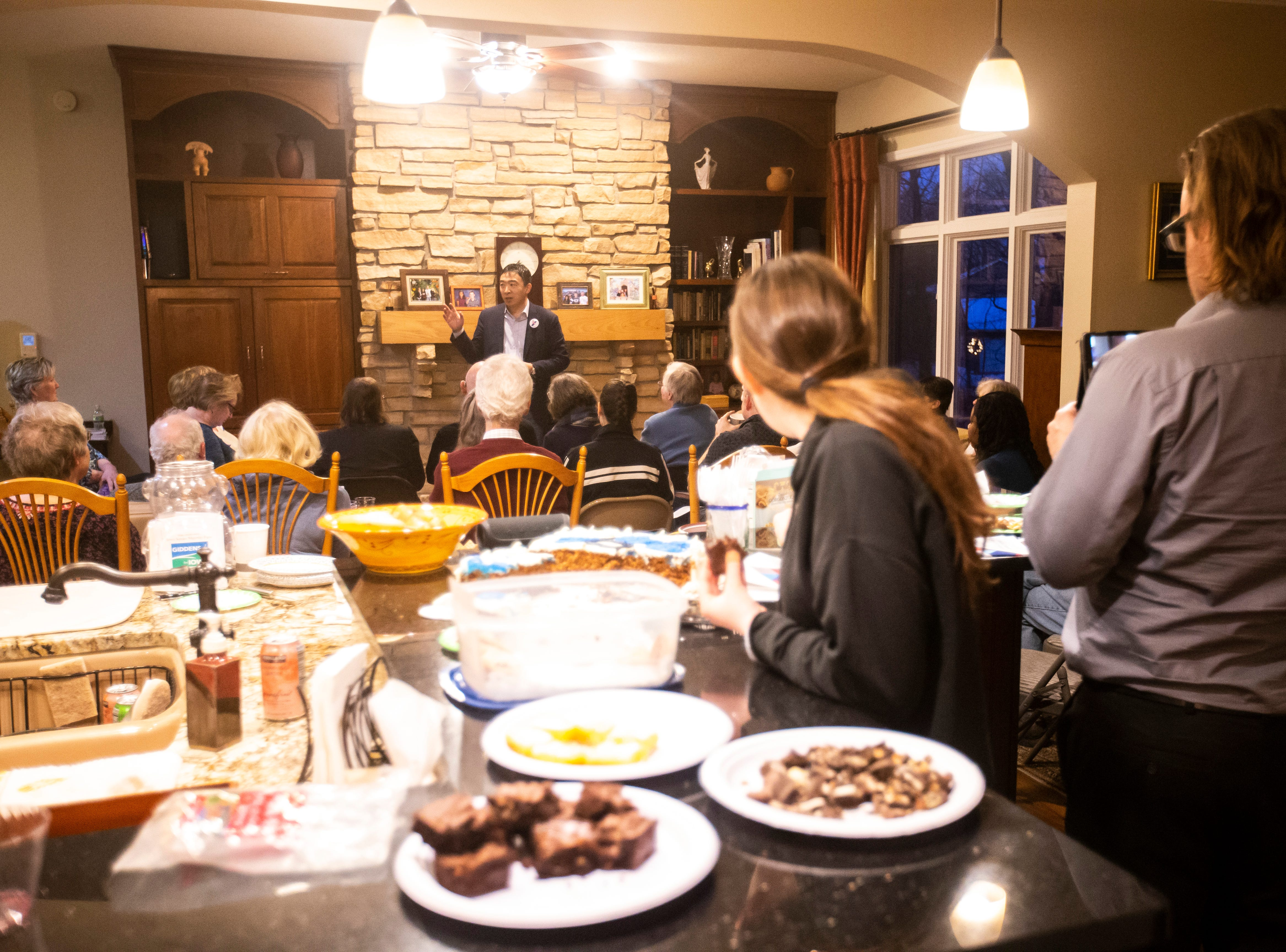 """Andrew Yang, a 2020 Democratic presidential candidate, speaks at the """"Potluck Insurgency,"""" a dinner party organized by local activists, on Sunday, March 10, 2019, at a home in Iowa City, Iowa."""