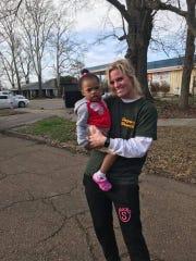 Leland firefighter Sara Hester with Raelynn Johnson