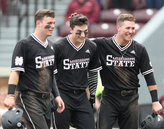 Mississippi State sophomore third baseman Justin Foscue (middle) celebrates a home run with teammates Tanner Allen (left) and Elijah MacNamee (right). Foscue leads the team with five home runs this season.
