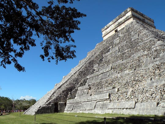 The El Castillo pyramid dominates the ancient Mayan ruins of Chichen Itza in Mexico's Yucatan Peninsula. The archaeological site also features temples, an astronomical observatory, ball court and colonnades. Some structures in the archaeological complex date to the 5th century.