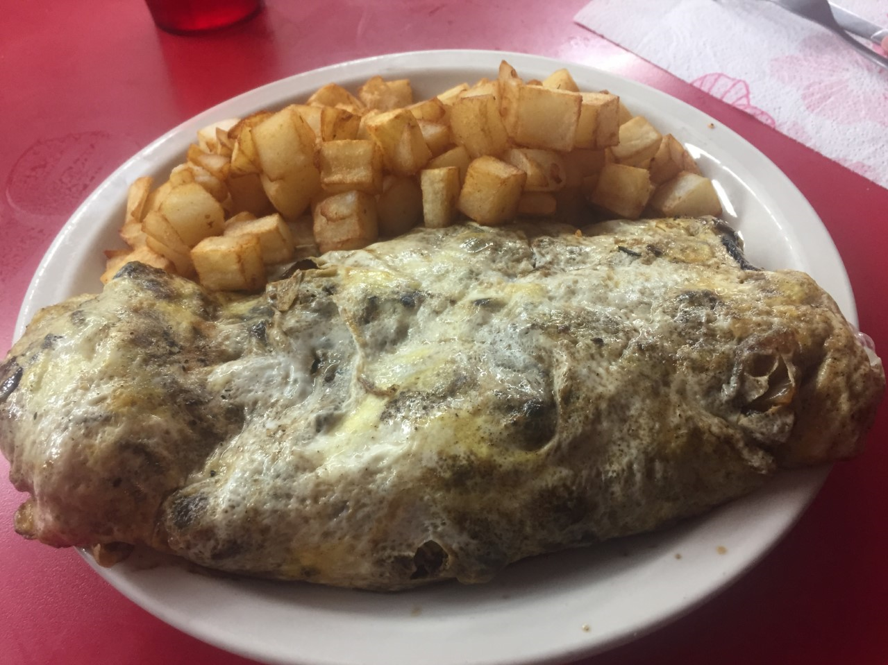 Inskip Grill's Magnolia Melt omelet is made with ribeye steak, mushrooms, onions, green peppers and a choice of cheese, and comes with a side of home fries.