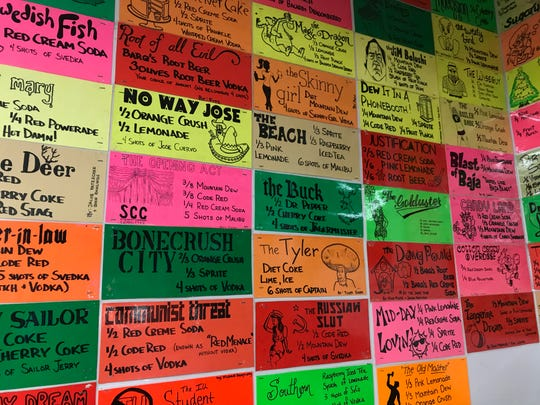 Recipes for fountain drinks called Den Pops line the wall at Discount Den in Chauncey Hill Mall.