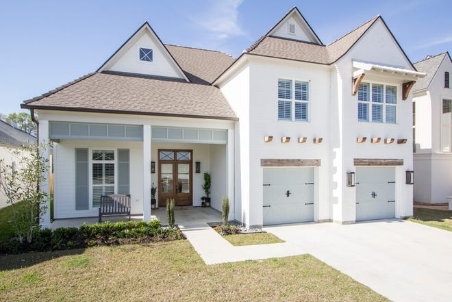 This 4 bedroom, 3 1/2 bath home is located at 400 Amber Pond Lane in Lafayette. It is listed at$735,000.