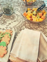 Cloth napkins cut down on waste and elevate the decor of a party.