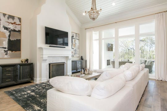 There are soaring ceilings and beautiful wood floors throughout the home.