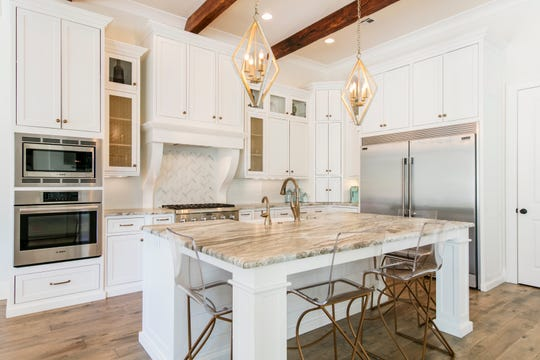 The gorgeous kitchen features top-of-the line everything.
