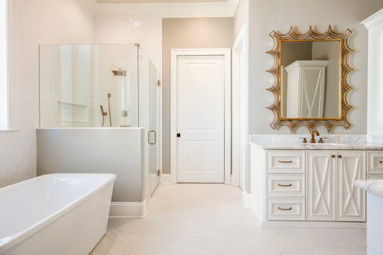 The spa-like master bath is a soothing oasis.