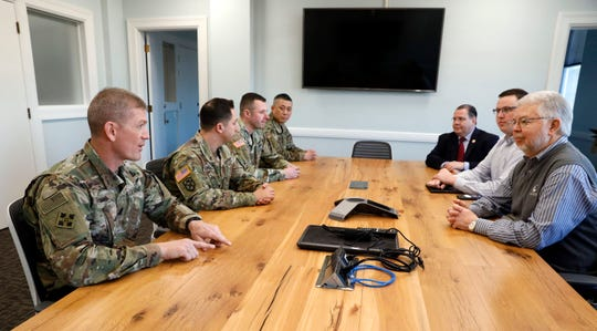 Command Sgt. Maj. T.J. Holland, left, talks with Lancaster Mayor David Scheffler, right, Will Lloyd, second from right, from U.S. Rep. Steve Stiver's office, and state Rep. Tim Schaffer, third from right, Monday morning, in Lancaster. Holland, who grew up in Lancaster and graduated from Amanda-Clearcreek High School in 1994. Holland, who's currently stationed at Fort Carson in Colorado, was visiting the city as part of the Army's campaign to send sergeants major back to their hometowns to meet with community members and talk about life in the Army. With Holland on his trip were members of the Army's central Ohio recruiting team.
