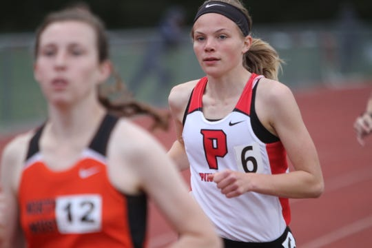 Pinckney's Noelle Adriaens won the 5,000-meter run in the New Balance Nationals Indoor meet in 17:11.47.