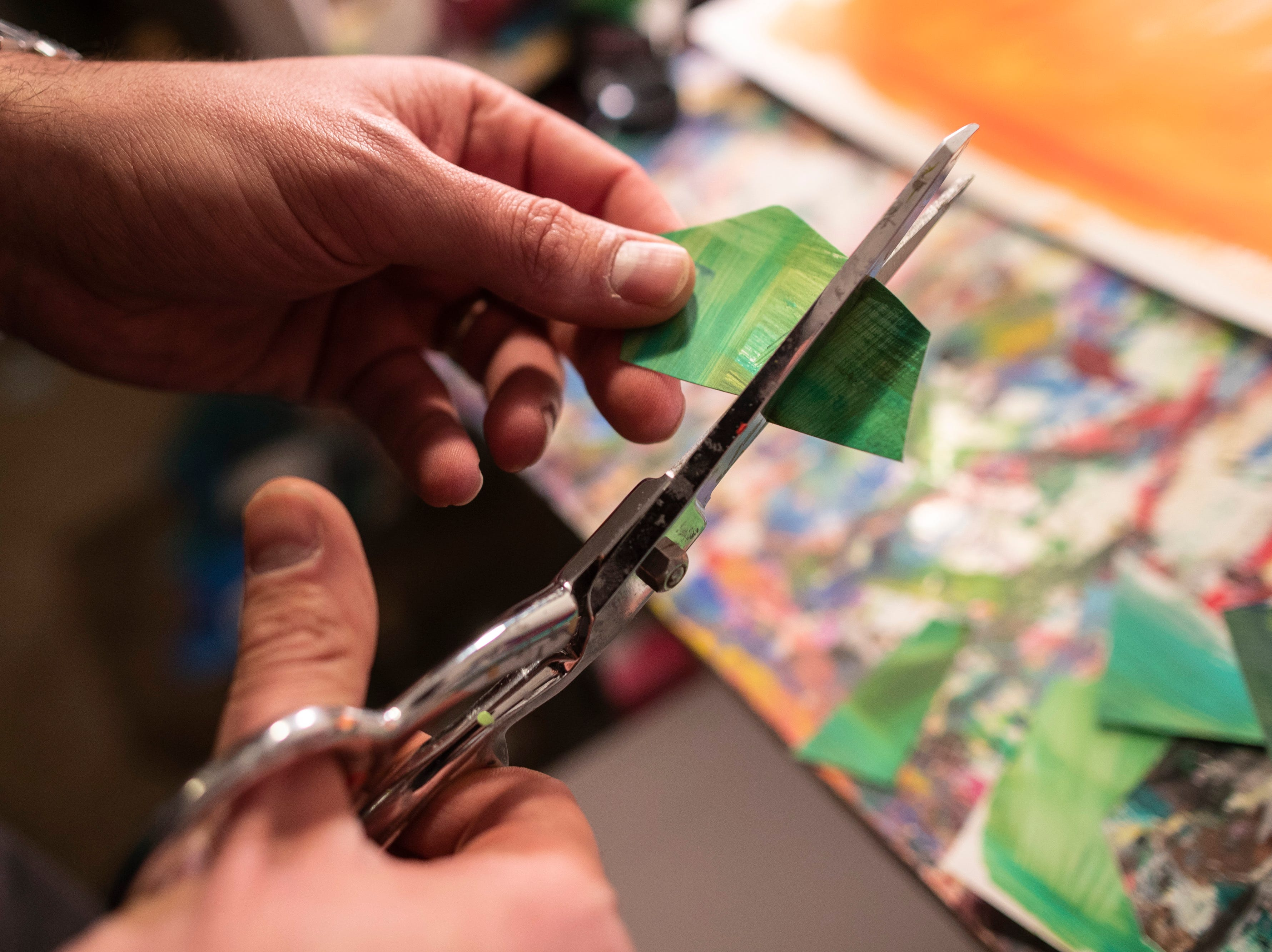 """Louisville artist Andy Perez works on projects in his home studio. My work is usually done with collage using pieces of paper that I paint first and then cut up and glue together,"""" Perez said. March 11, 2019"""