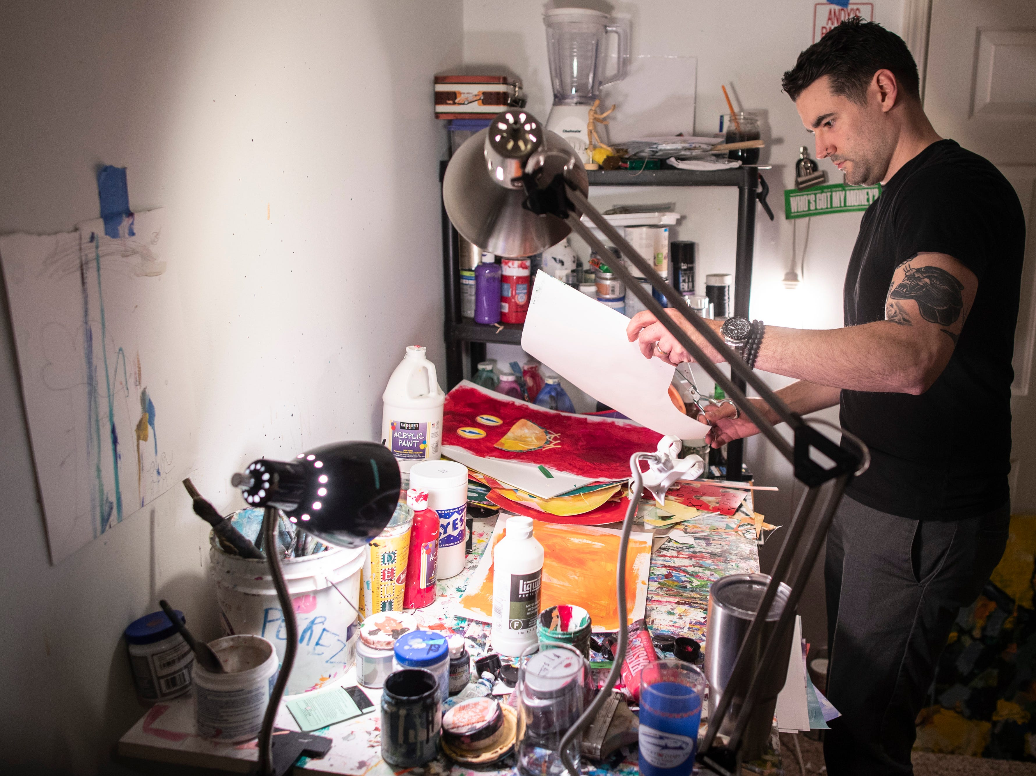 Louisville artist Andy Perez works on projects in his home studio. Perez graduated college in 2004 and has been doing work professionally since that time. March 11, 2019