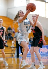 Lansing Catholic's Devan Buda goes up for a layup against Jackson Northwest's Anya Hedrich, Monday, March 11, 2019, in Ionia, Mich.