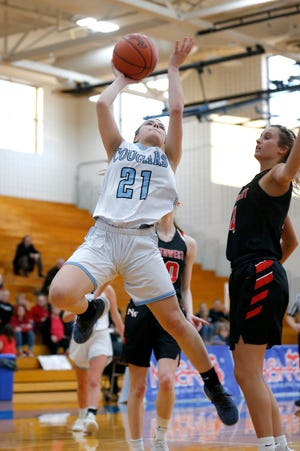 Lansing Catholic's Lauren Hanes, left, puts up a shot against Jackson Northwest's Baileigh Ryan, Monday, March 11, 2019, in Ionia, Mich.