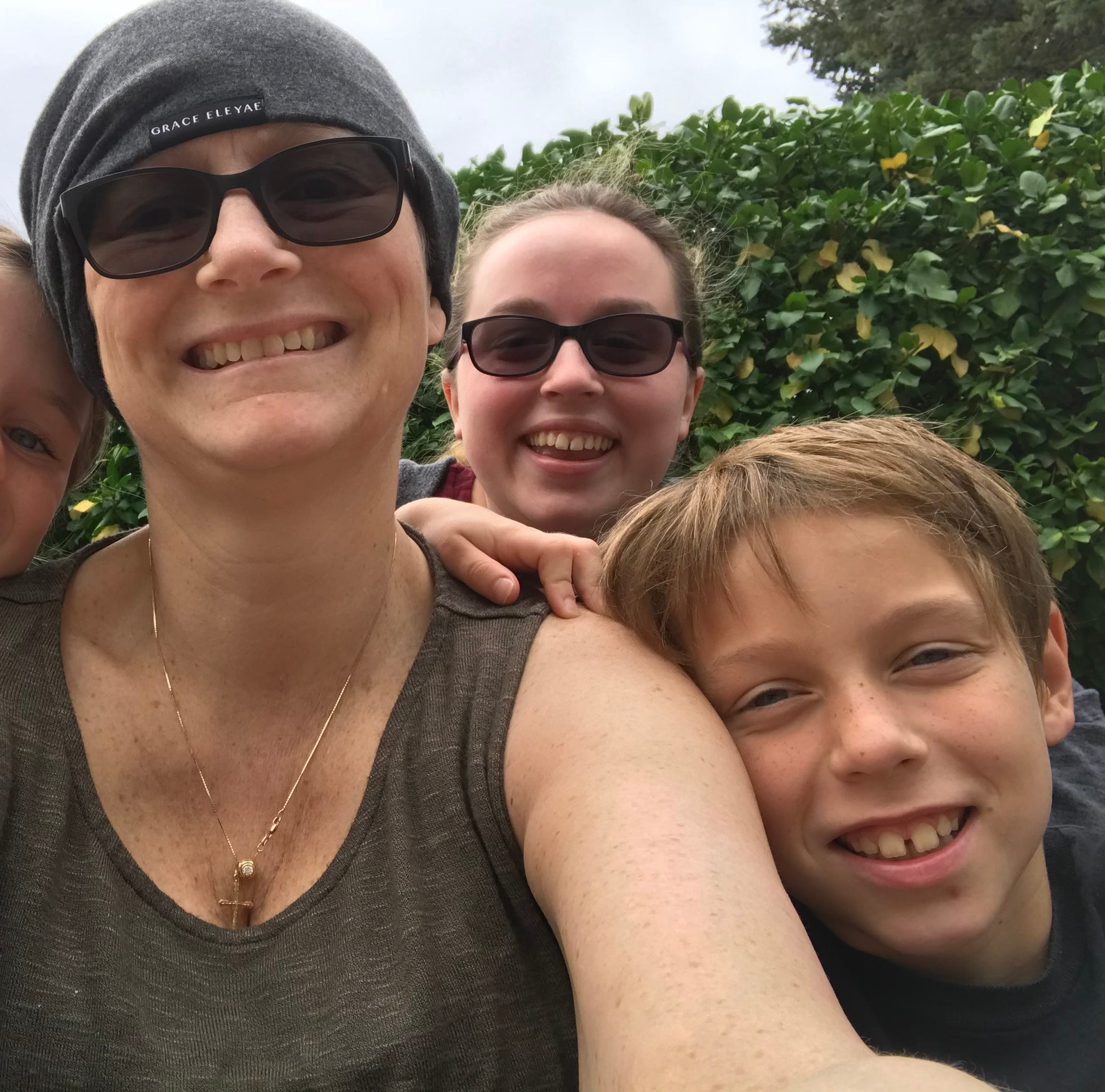 Attorney Jenifer Pettibone of Holt with her children, MacKenzie, 8, Madison, 17, and Joseph, 10. Pettibone took the photo during a break in cancer treatment in 2018. She died May 9, 2019.