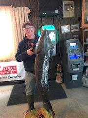 """Mark Oakley claims the top prize for the group of 15 Manitowoc County sturgeon spearers, naming him """"Sturgeon King"""" for this year. Mark shows his 65-pound, 65-inch sturgeon he took during the 2019 season. Mark will have the bragging rights as """"Sturgeon King"""" until next season."""