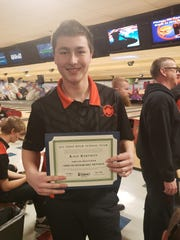 Ashland senior Kage Bartman with his All-Ohio certificate after finishing 12th individually among 100 bowlers in the Division I state tournament.