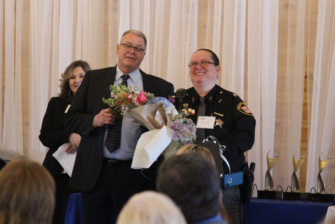 Major Christy Utley, with the Marion County Sheriff's Office, is the winner of the 2019 Athena Award, which was presented Monday by the Marion Women's Business Council. Marion County Commissioner Andy Appelfeller, left, a former law enforcement officer, congratulates Utley.