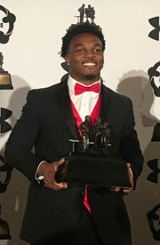 Nakobe Dean poses with the 2019 Watkins Award trophy.