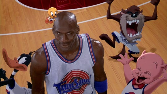 """Michael Jordan shoots hoops while his animated friends hoot and holler in """"Space Jam,"""" which screens Friday night at the Orpheum."""