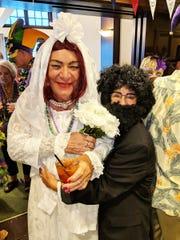 Tom Krepelka (bride) and Dalia Krepelka (groom) joined the Mardi Gras fun at the Marco Island Yacht Club.