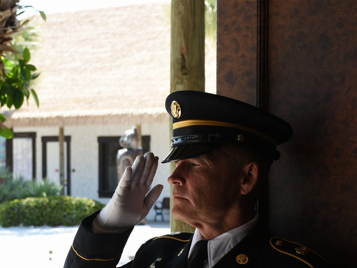 "An Army honor guard bugler plays ""Taps"" to honor Herb Savage, a retired colonel. The life of iconic island architect Herb Savage was celebrated in a ceremony Sunday afternoon at the Rose History Auditorium, with military honors and reminisces from family and friends."
