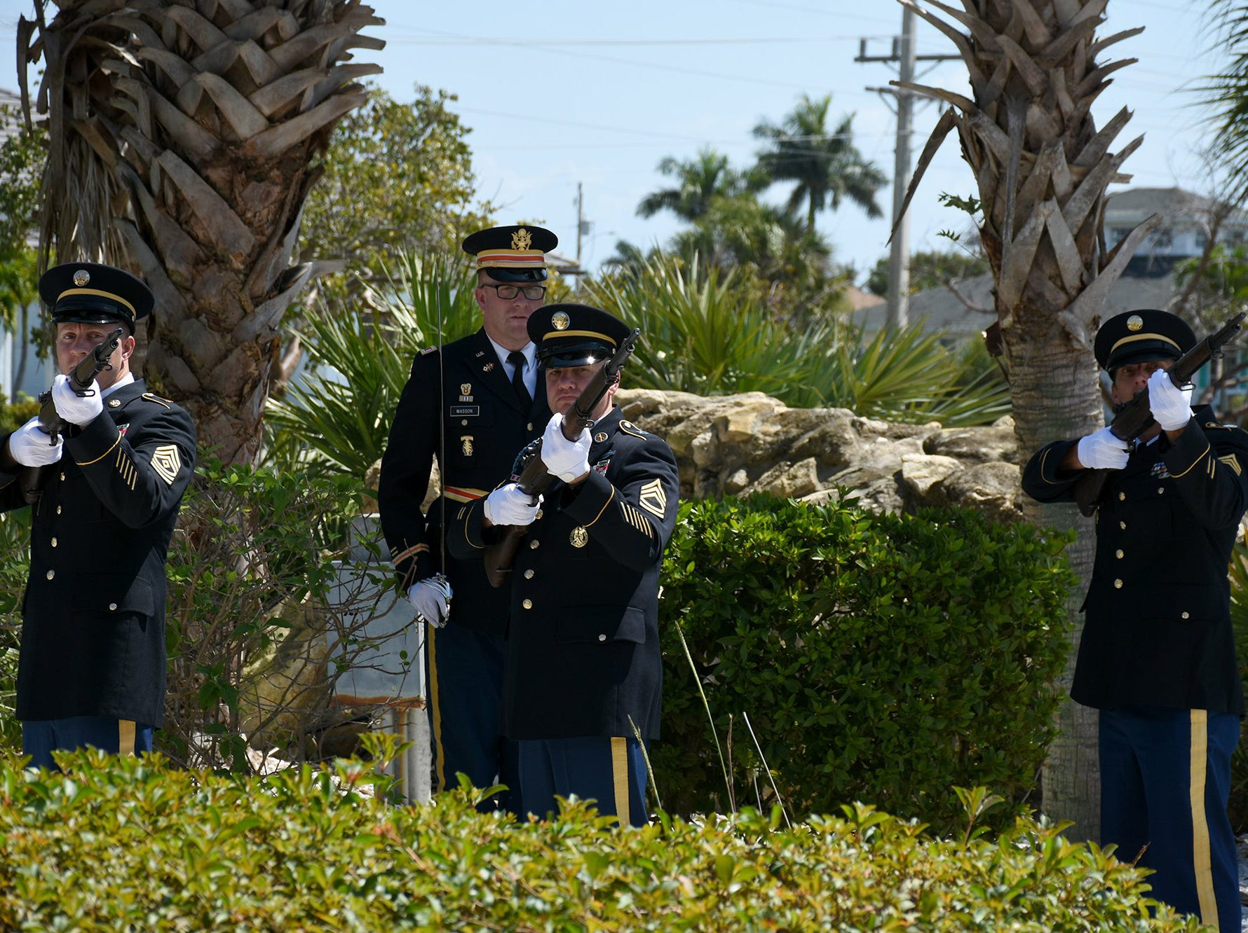 An Army honor guard fires three volleys to honor Herb Savage, a retired colonel. The life of iconic island architect Herb Savage was celebrated in a ceremony Sunday afternoon at the Rose History Auditorium, with military honors and reminisces from family and friends.