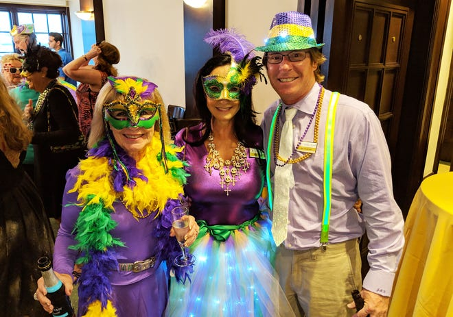 Marco Island Yacht Club members came dressed in their best Mardi Gras attire. From left, Judi Hughes, Mary Harris and Jay Hughes.