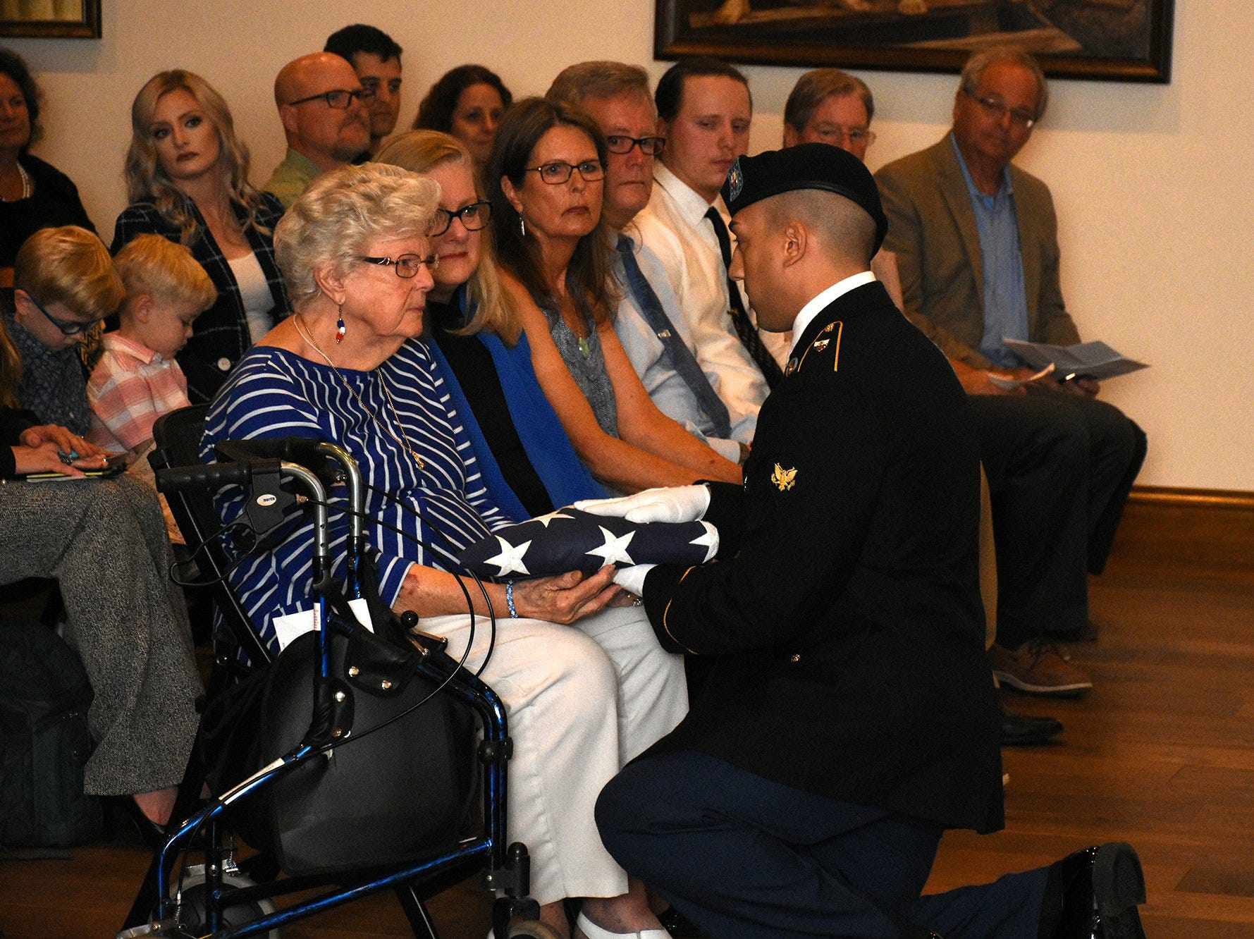 Emily Savage is presented with a flag by Army Specialist Malek Baker, married to her granddaughter. The life of iconic island architect Herb Savage was celebrated in a ceremony Sunday afternoon at the Rose History Auditorium, with military honors and reminisces from family and friends.