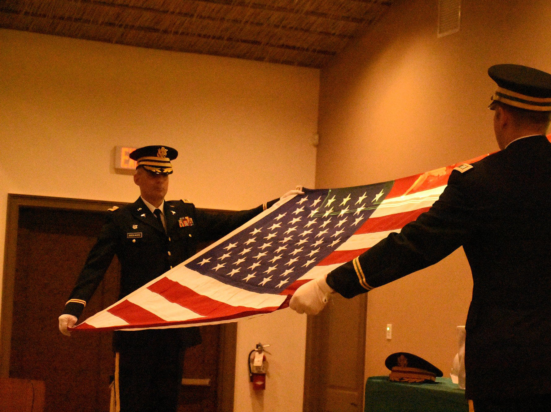 An Army honor guard folds a flag to present to Emily Savage. The life of iconic island architect Herb Savage was celebrated in a ceremony Sunday afternoon at the Rose History Auditorium, with military honors and reminisces from family and friends.