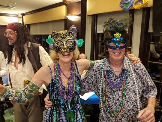 Yacht Club members Linda and Alan Sandlin won extra beads and top prize for their Mardi Gras '70s look costumes.