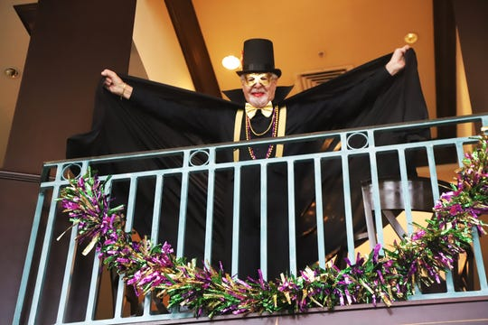 Just like on Bourbon Street in New Orleans, Tom Jobe greeted Mardi Gras participants from the balcony.