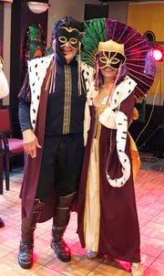 Marco Island Yacht Club Members Kathy and Roy Hershberger, who have homes in New Orleans and Marco Island, planned an authentic Mardi Gras carnival celebration that included music, a parade and Creole food.