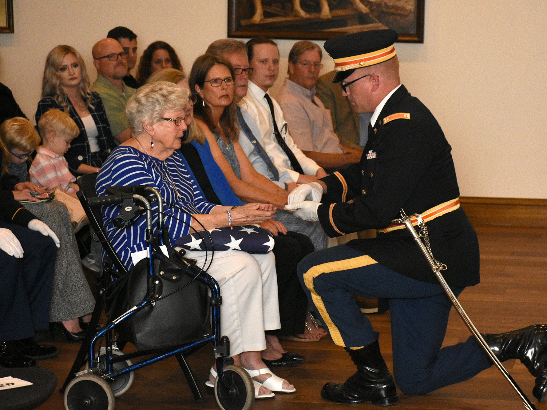 Emily Savage is presented with a flag by the Army honor guard. The life of iconic island architect Herb Savage was celebrated in a ceremony Sunday afternoon at the Rose History Auditorium, with military honors and reminisces from family and friends.