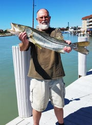 Bob Brown with largest fish (snook) caught during tournament.