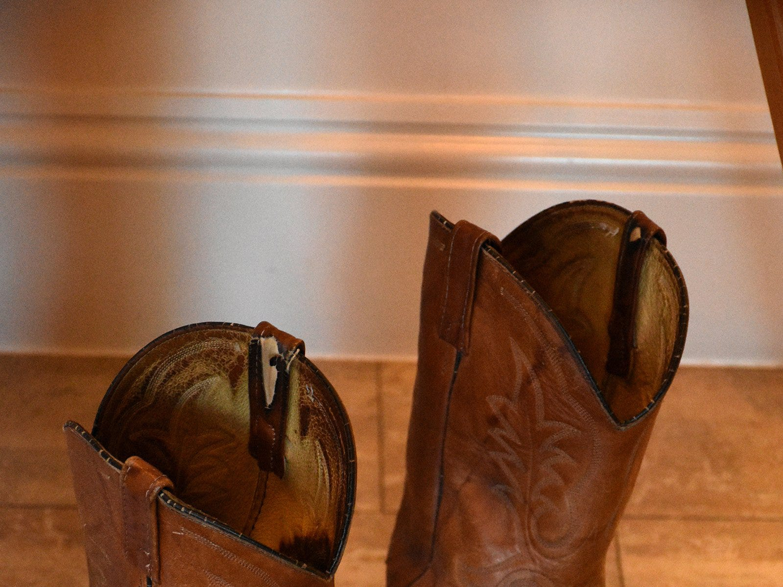 Herb's cowboy boots are displayed in the lobby. The life of iconic island architect Herb Savage was celebrated in a ceremony Sunday afternoon at the Rose History Auditorium, with military honors and reminisces from family and friends.