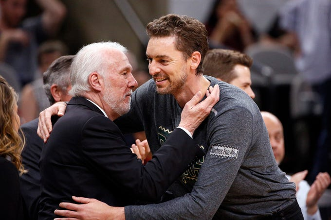Recently acquired Bucks center Pau Gasol gives Spurs coach Gregg Popovich, his former boss, a hug before the teams played on Sunday night at AT&T Center in San Antonio.