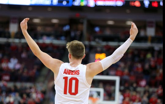 Buckeyes forward Justin Ahrens tries to get the crowd going after hitting one of his 3 three-pointers during Ohio State's second half comeback against Wisconsin on Saturday.