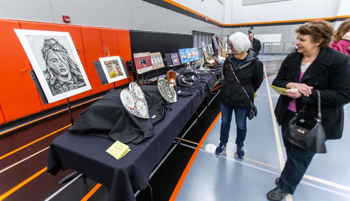Nina Soukup (left) of Cedarburg and Susan Durant of Germantown look over the student artwork during the 7th annual Art in the Burg art fair at Cedarburg High School (CHS) on Saturday, March 9, 2019. The event, sponsored by the CHS Fine Arts Boosters and Art Department, features 75 artists from the midwest exhibiting and selling original work in many artistic disciplines.