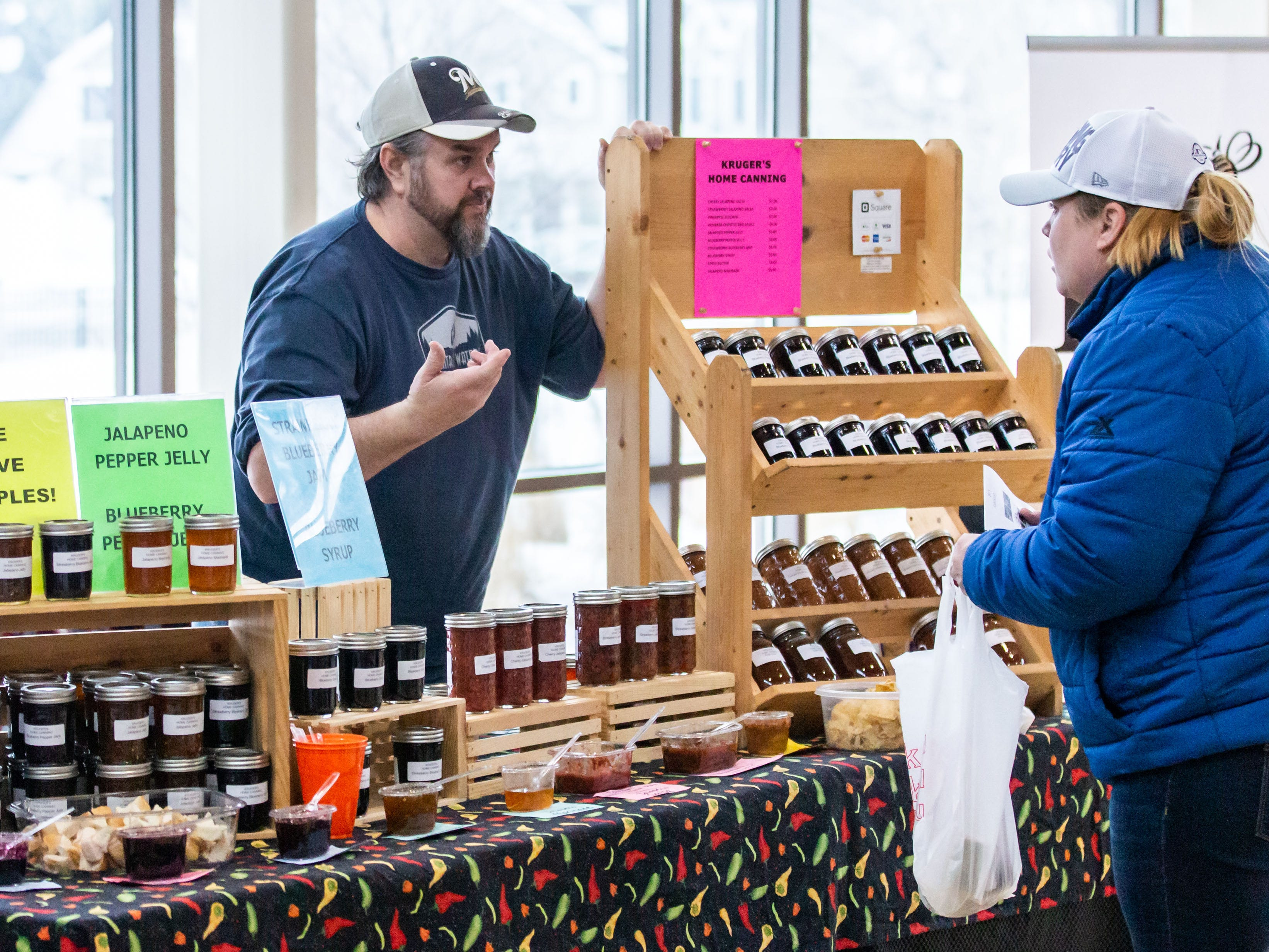 Jessie Kruger of Kruger's Home Canning in Watertown chats with a customer during the Winter Farmers Market at the Sussex Civic Center on Sunday, March 10, 2019.