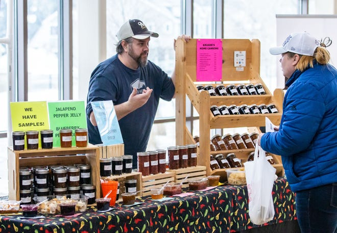 A vendor chats with a customer during the winter farmers market in Sussex last year. Johnathan Martin is hoping to reopen both the summer farmers market and the winter market.