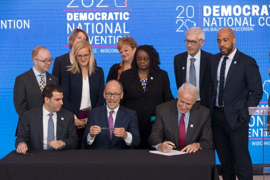 Democratic National Committee chairman Tom Perez (center) examines a pen while Milwaukee Mayor Tom Barrett (right) signs a convention contract along with Milwaukee Bucks Senior Vice President Alex Lasry  (left) following the official announcement that Milwaukee will host the 2020 Democratic National Convention at Fiserv Forum on Monday. Milwaukee snagged the event over Houston and Miami.