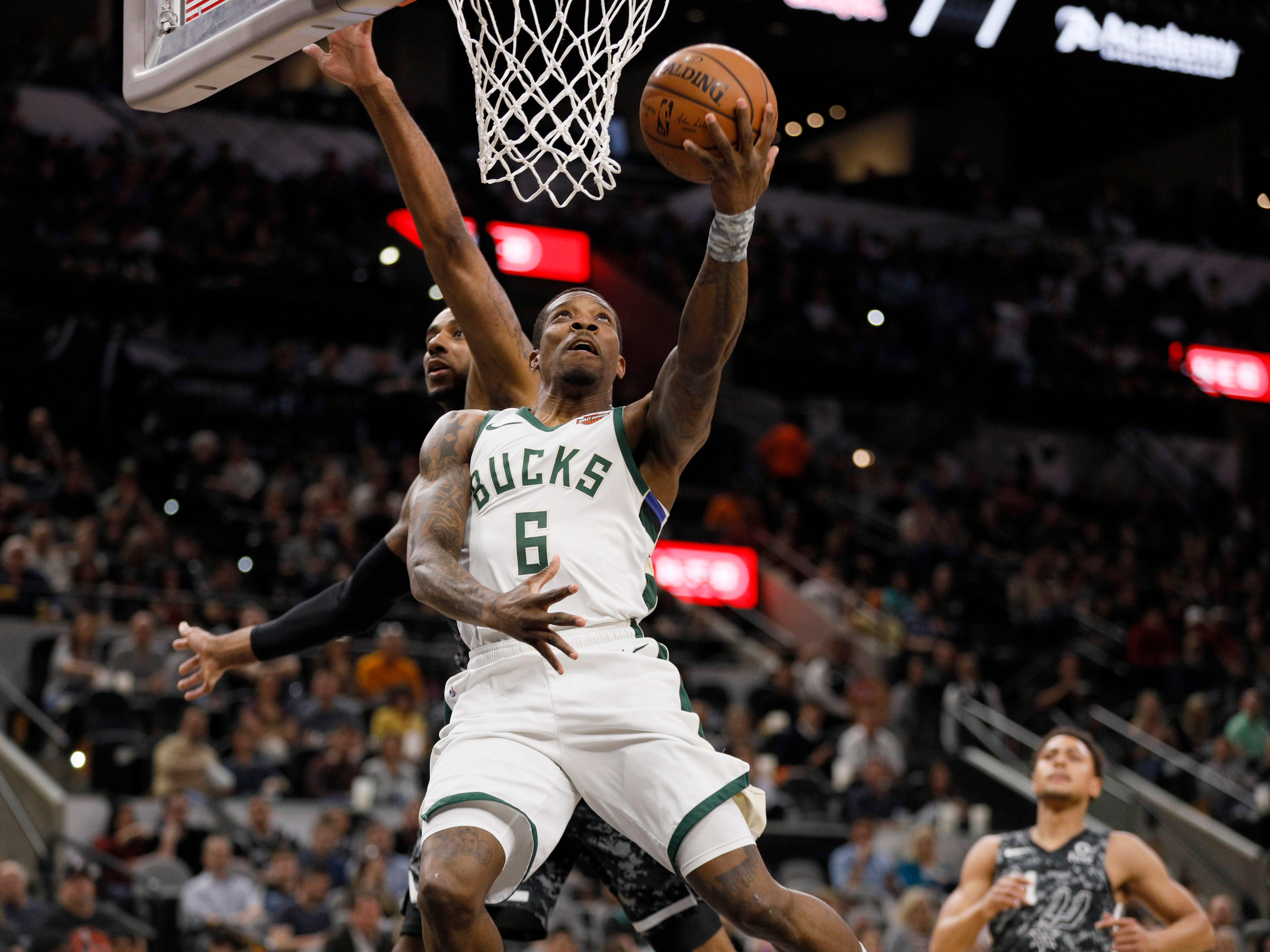 Bucks point guard Eric Bledsoe goes in for a reverse layup in front of the Spurs' LaMarcus Aldridge during the first half.