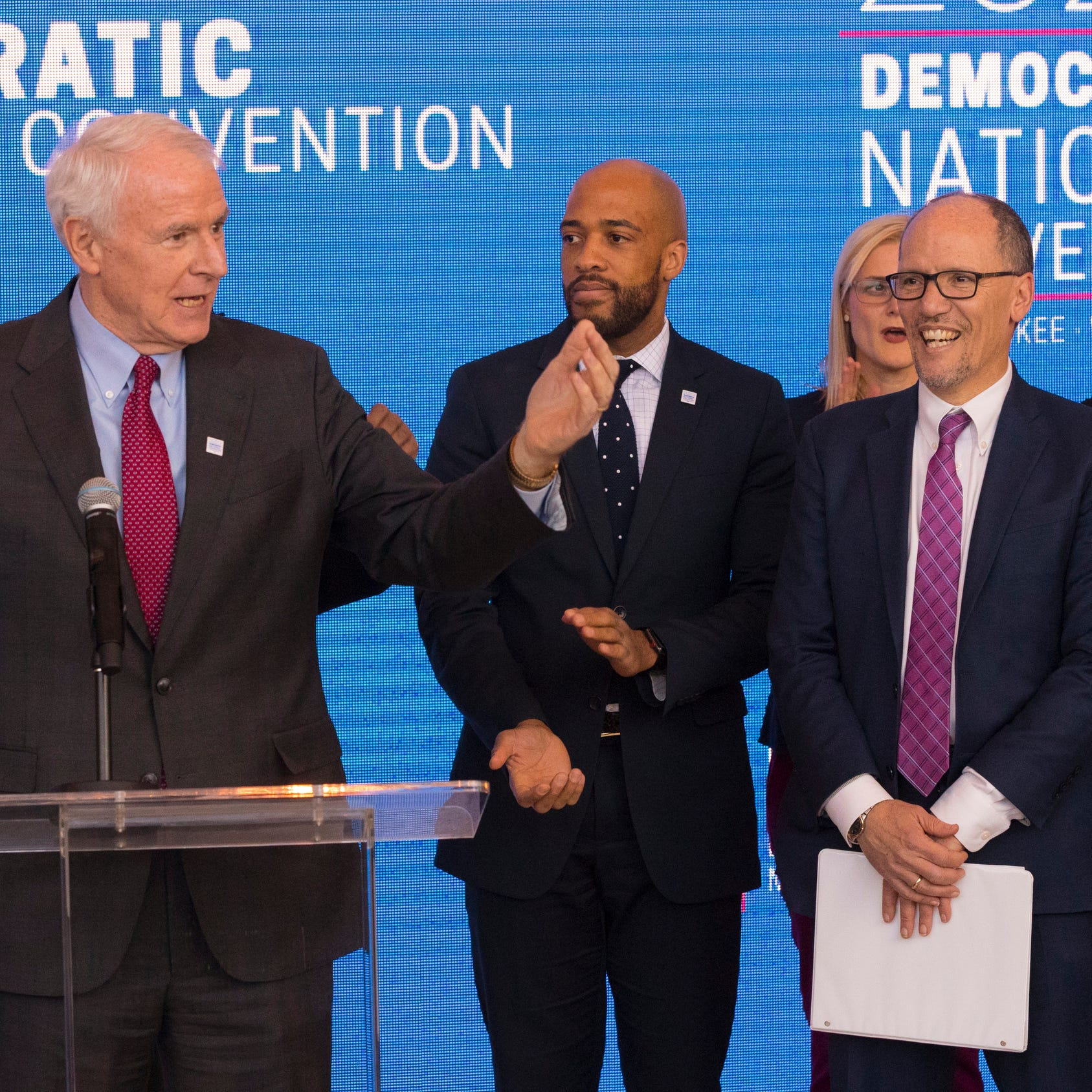 Milwaukee Mayor Tom Barrett (left) speaks during the official announcement that Milwaukee will host the 2020 Democratic National Convention at Fiserv Forum on Monday. Standing to his left are Lt. Gov. Mandela Barnes, Democratic National Committee Chairman Tom Perez and Gov. Tony Evers.