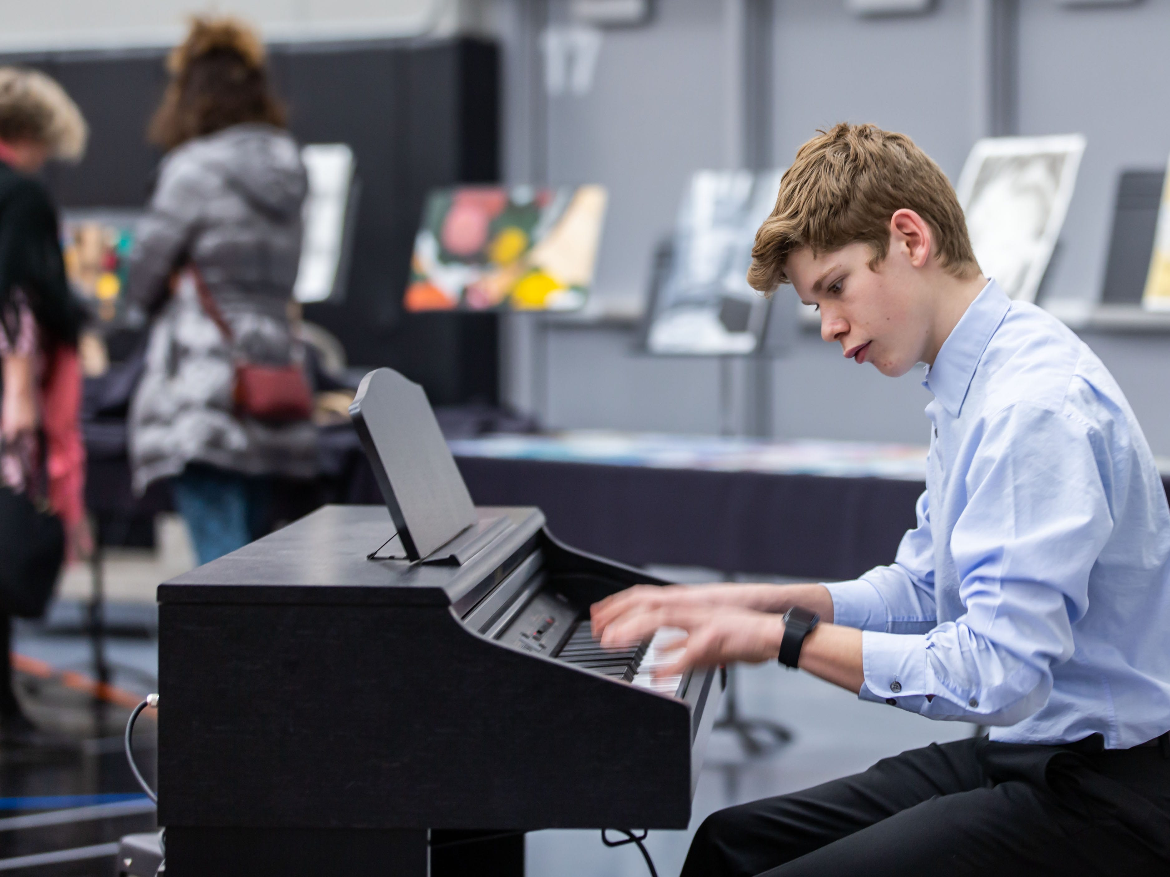 Sophomore Breck Golden entertains attendees during the 7th annual Art in the Burg art fair at Cedarburg High School (CHS) on Saturday, March 9, 2019. The event, sponsored by the CHS Fine Arts Boosters and Art Department, features 75 artists from the midwest exhibiting and selling original work in many artistic disciplines.
