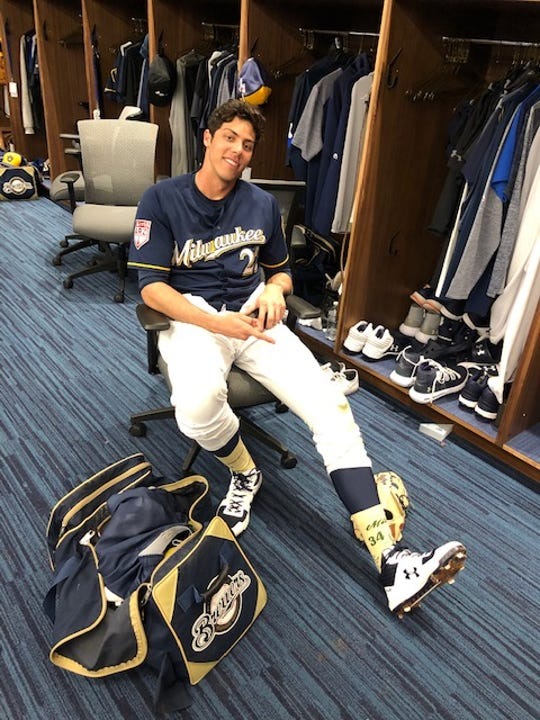 Christian Yelich shows off the Giannis Antetokounmpo socks he wore Monday.