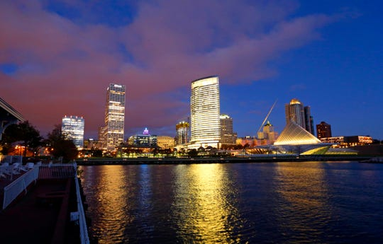 In this Oct. 31, 2017 photo, the downtown skyline over looks Lake Michigan in Milwaukee. The Democratic National Committee has selected Milwaukee to host the 2020 national convention.