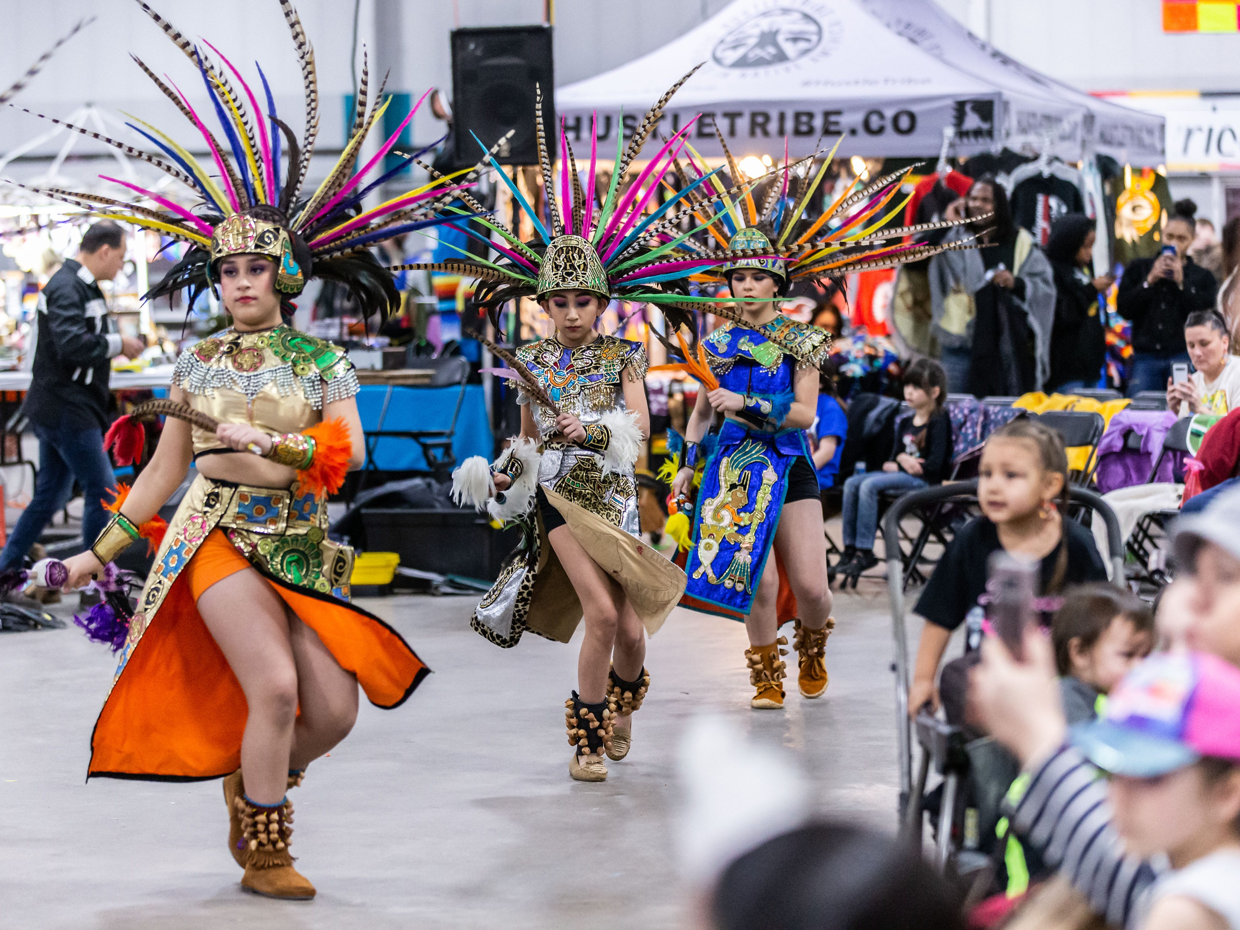 Dancers from Milwaukee's Dance Academy of Mexico perform for spectators during the Indian Summer Festival's 28th annual Winter Pow Wow at Wisconsin State Fair Park on Sunday, March 10, 2019.